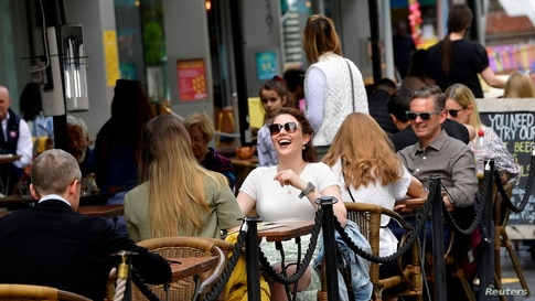 FILE PHOTO: People relax at outdoor dining areas on the South Bank, as lockdown restrictions continue to ease amidst the spread…