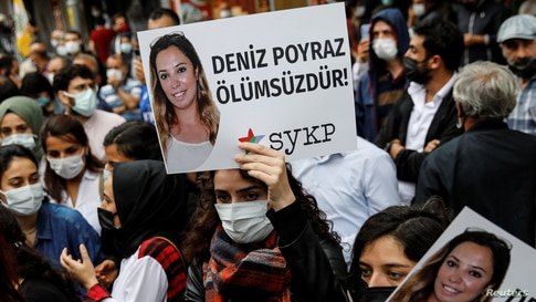 Demonstrators carry pictures of Deniz Poyraz, who was killed in an attack on a local office of the pro-Kurdish Peoples'…