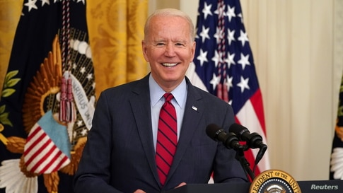 U.S. President Joe Biden smiles as he delivers remarks on the bipartisan infrastructure deal in the East Room of the White…
