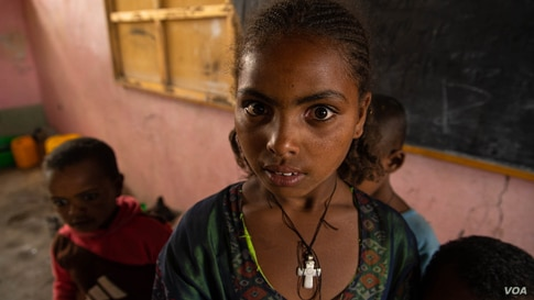 A young girl lives in a classroom on June 3, 2021, in Mekelle, Ethiopia. About 2 million people have been displaced since November 2020, when the war began. (VOA/Yan Boechat)