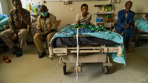 A wounded boy sits on a bed in the Ayder Referral Hospital on June 4, 2021, in Mekelle, Ethiopia. (VOA/Yan Boechat)