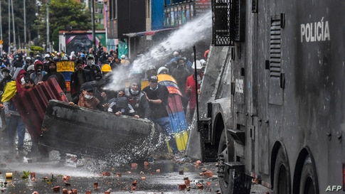 Police officers spray a water cannon at demonstrators during a protest against the government of Colombian President Ivan Duque in Bogota, June 9, 2021.