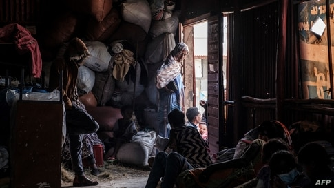 Internally displaced people take refuge at a temporary shelter in Debre Berhan, Ethiopia.More than 100 civilians died in a recent flare-up of violence in the town of Ataye that also saw the assailants torch more than 1,500 buildings.