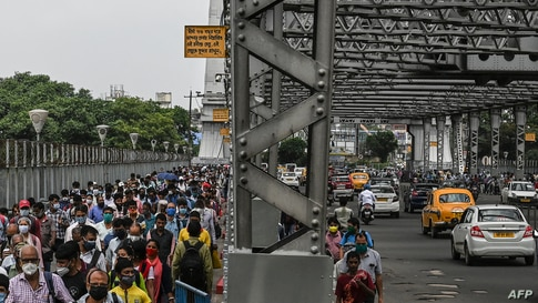 Commuters cross the Howrah Bridge as the state government suspends regular public transport during a lockdown imposed to curb the spread of the Covid-19 in Kolkata, India.