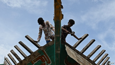Workers carry out maintenance work on a fishing vessel at Kasimedu fishing harbor after the government eased a lockdown against the Covid-19 pandemic in Chennai, India.