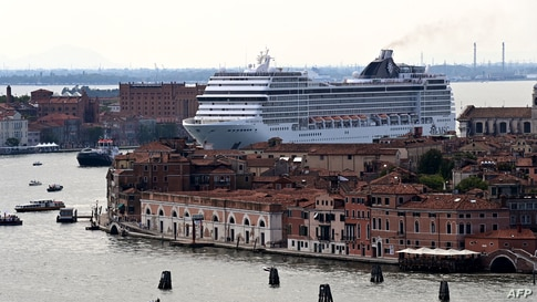 The MSC Orchestra cruise ship sails across the basin as it leaves Venice, Italy, June 05, 2021.