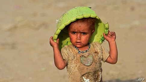 An Afghan refugee child plays on the outskirts of Lahore, Pakistan, June 19, 2021.