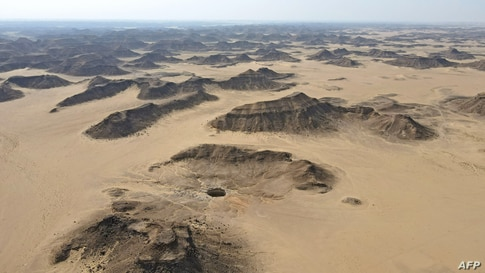 """An aerial view shows the Well of Barhout known as the """"Well of Hell"""" in the desert of Yemen's Al-Mahra province."""