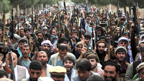 Militiamen join Afghan defense and security forces during a gathering in Kabul.