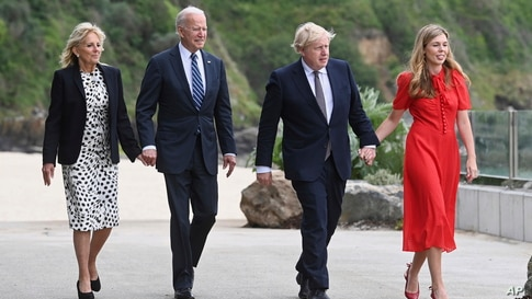 Britain's Prime Minister Boris Johnson, his wife Carrie Johnson and U.S. President Joe Biden with first lady Jill Biden walk outside Carbis Bay Hotel, Carbis Bay, Cornwall, Britain, ahead of the G7 summit.
