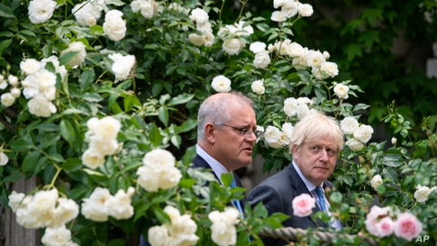 Britain's Prime Minister Boris Johnson, right, walks with Australian Prime Minister Scott Morrison after their meeting, in the garden of 10 Downing Street, in London.