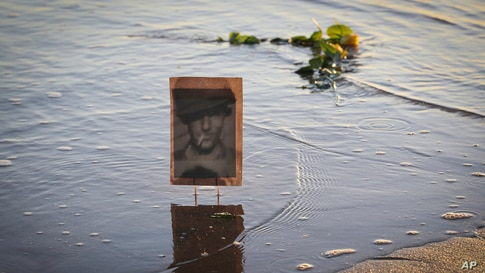 A picture of an unknown soldier is seen on the shore of Omaha Beach in Saint Laurent sur mer, Normandy, France, on the eve of 77th anniversary of the assault that helped bring an end to World War II.