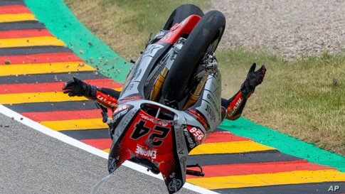Italian rider Simone Corsi of Team Tasca Racing Scuderia crashes in the Moto2 race at the Sachsenring circuit in Hohenstein-Ernstthal, Germany.