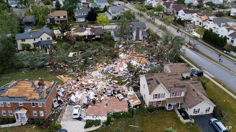 A home on the 1800 block of Princeton Circle is leveled after an overnight tornado swept through the area in Naperville, Illinois.