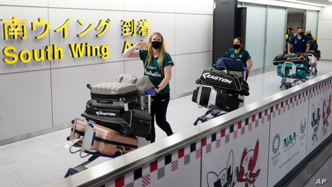 Members of Australia's Olympic softball squad, the first national team to come to Japan for pre-Olympic training camp arrive at Narita international airport in Narita, east of Tokyo.
