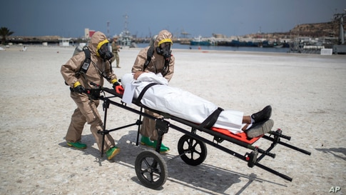 Members of the Moroccan Royal Armed Forces Rescue & Relief Unit take part in a biochemical simulation organized by the U.S Defense Threat Reduction Agency in the port of Agadir, southern Morocco.