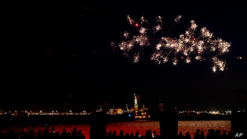 Fireworks explode over New York Harbor and the Statue of Liberty as New York state celebrates a 70% vaccination against the COVID-19 virus, June 15, 2021.