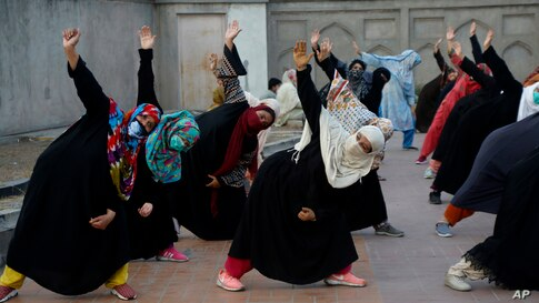 Women take part in yoga session in the historical Shalimar Garden in Lahore, Pakistan.
