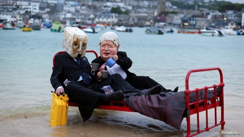 Activists from climate action group Ocean Rebellion demonstrate in St. Ives Harbor, Cornwall, Britain, ahead of the G7 summit.