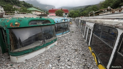 Trolleybuses are seen damaged after heavy rainfall and floods in Yalta, Crimea.