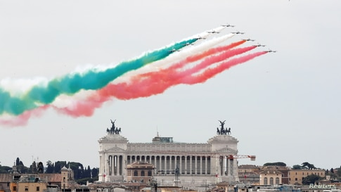 The aerobatic demonstration team of the Italian Air Force, the Frecce Tricolori (Tricolor Arrows), performs over the city on Republic Day, in Rome.
