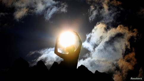 A person celebrates the summer solstice at the Kokino megalithic observatory, near the city of Kumanovo, North Macedonia.