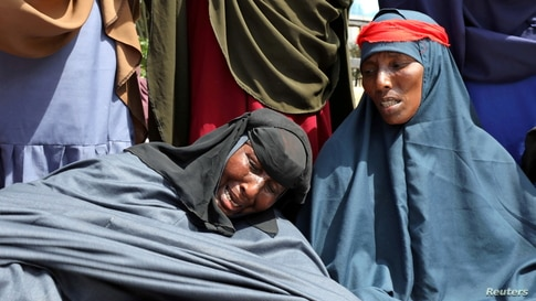 Somali women who say their sons have been used as fighters in the Tigray conflict in neighboring Ethiopia, react during a protest in Mogadishu, Somalia.