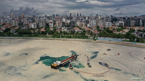 Sea-surface cleaning vessels and barrier-laying boats of Istanbul Municipality clean up the sea snot, a thick slimy layer of the organic matter also known as marine mucilage, spreading through the Sea of Marmara, Turkey.