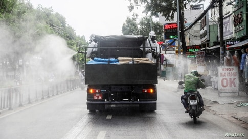 A truck sprays disinfectant amid the COVID-19 outbreak in Ho Chi Minh city, Vietnam, June 1, 2021.
