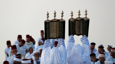Members of the Samaritan sect take part in a traditional pilgrimage marking the holiday of Shavuot, atop Mount Gerizim near Nablus in the Israeli-occupied West Bank.