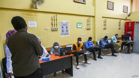 People wait to receive a dose of the Oxford-AstraZeneca COVID-19 coronavirus vaccine at the Jabra Hospital for Emergency and…