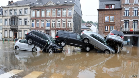 A picture taken on July 15, 2021 shows cars piled up by the water at a roundabout in the Belgian city of Verviers, after heavy…
