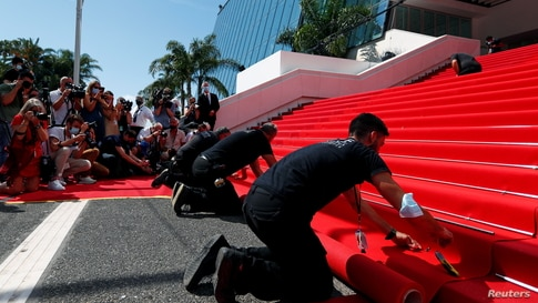 The 74th Cannes Film Festival - Red carpet installation - Cannes, France, July 6, 2021. Photographers and cameramen watch as…
