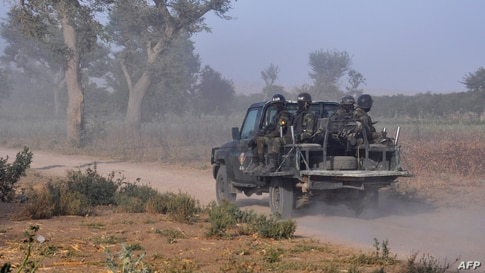 FILE - Members of the Cameroonian Rapid Intervention Force patrol on the outskirt of Mosogo in the far north region of the country where Boko Haram jihadist have been active, March 21, 2019.