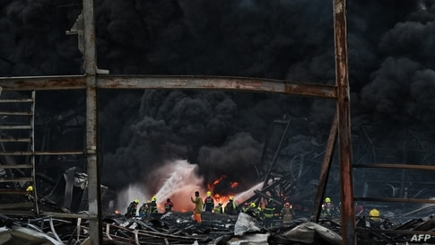 Firefighters work at the site of an explosion and fire at a plastics factory on the outskirts of Bangkok, Thailand.