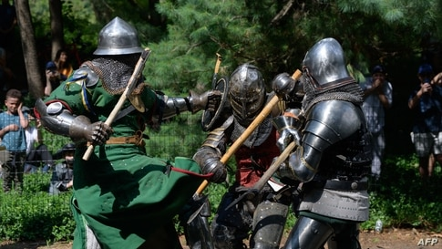 Members of the 'Gladiators NYC' armored combat group fight in Central Park, New York, July 10, 2021.