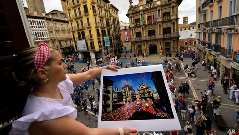 Cristina Esparza holds a San Fermin July 2019 photograph, in Pamplona, northern Spain, Tuesday July 6, 2021, on the day the '…