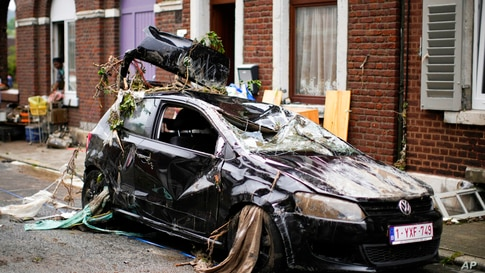 A car is strewn with debris in a residential street after flooding in Ensival, Verviers, Belgium, Friday July 16, 2021. Severe…