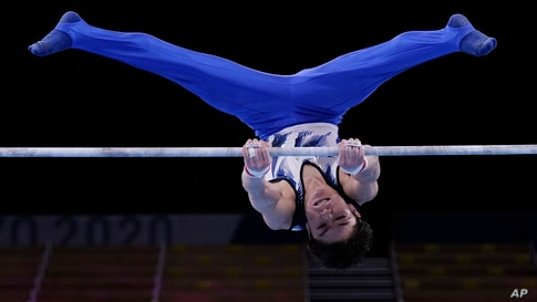 Kohei Uchimura, of Japan, competes on the horizontal bar during the men's artistic gymnastic qualifications at the 2020 Summer Olympics, July 24, 2021, in Tokyo, Japan.