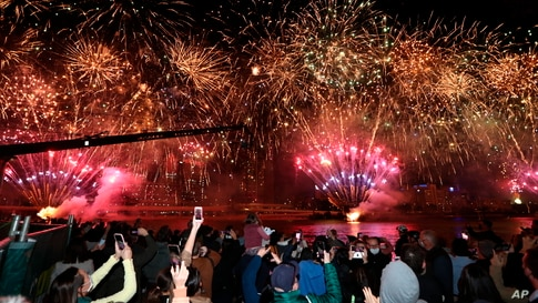 People celebrate in Brisbane, Australia, following an announcement by the International Olympic Committee that Brisbane was picked to host the 2032 Olympics.