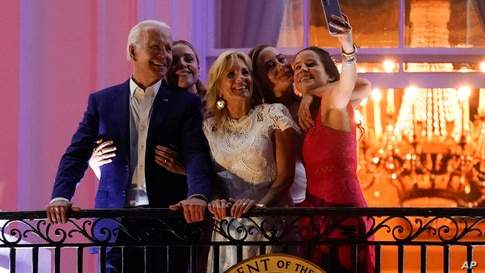 President Joe Biden poses for a photo with granddaughter Finnegan Biden, from left, first lady Jill Biden, granddaughter Naomi Biden and daughter Ashley Biden as they view fireworks during an Independence Day celebration at the White House, Washington.