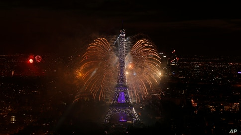 A view of the fireworks display by the Eiffel tower on Bastille Day, in Paris, France.