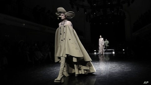 A model wears a creation for Jean Paul Gaultier's Haute Couture Fall-Winter 2021-2022 fashion collection presented in Paris.