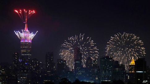 Fireworks explode from the Empire State Building and over the New York City skyline during Macy's 4th of July fireworks display, July 4, 2021, as seen from Jersey City, New Jersey.