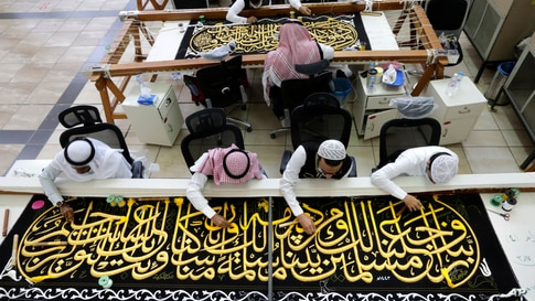 Saudi workers embroider Islamic calligraphy at the Kiswa factory in Mecca, Saudi Arabia, during the final stages in the preparation of a drape, or Kiswa, that covers the Kaaba, a cube-shaped structure at the heart the Grand Mosque.