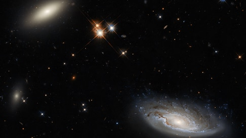 The NASA/ESA Hubble Space Telescope captures lenticular galaxy, L, and the spiral galaxy named UGC 2665, R. Both enormous galaxies form part of the enormous Perseus galaxy cluster. (Credit: ESA/Hubble & NASA, W. Harris)