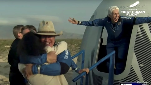 In this still image from video by Blue Origin shows billionaire Jeff Bezos and Wally Funk emerge from New Shepard rocket on the world's first unpiloted suborbital flight near Van Horn, Texas.