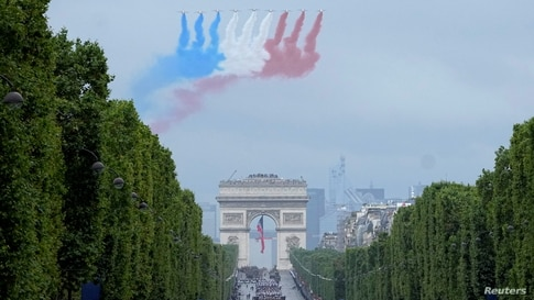 Jets of the Patrouille de France fly over the Champs-Elysees avenue during the Bastille Day parade in Paris.