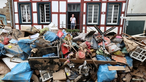 A man looks on outside a house in an area affected by floods caused by heavy rainfalls in Bad Muenstereifel, Germany.