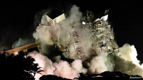 The partially collapsed Champlain Towers South residential building is demolished in Surfside, Florida, July 4, 2021.